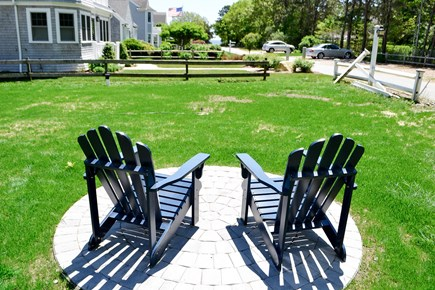 Mashpee, Popponesset Cape Cod vacation rental - 2 Adirondack chairs facing the ocean. 1 min walk to private beach