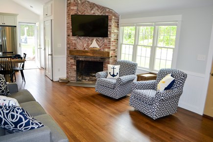 Mashpee, Popponesset Cape Cod vacation rental - Another view of living room with fireplace.