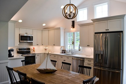 Mashpee, Popponesset Cape Cod vacation rental - Open bright kitchen. Large dining room table which seats 8.