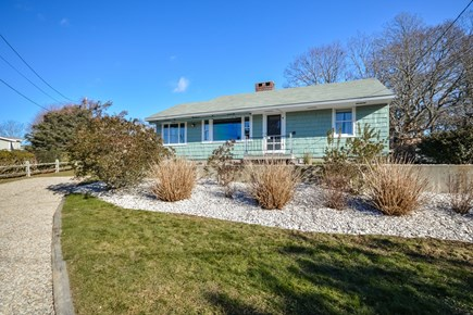 Falmouth Cape Cod vacation rental - Classic Ranch style home with picture windows looking at water.