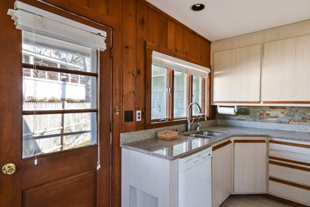 Falmouth Cape Cod vacation rental - Kitchen and back door.