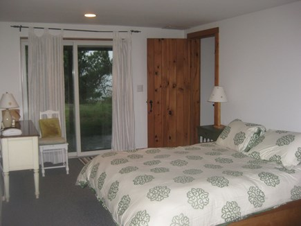 Truro Cape Cod vacation rental - Downstairs bedroom , queen bed water view , bathroom close