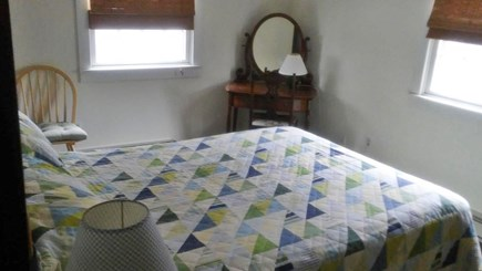 Provincetown Cape Cod vacation rental - Comfortable queen bed in rear bedroom with closet and dresser.