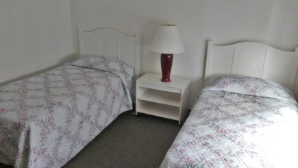 Provincetown Cape Cod vacation rental - The middle bedroom boasts twin beds a closet and dresser.
