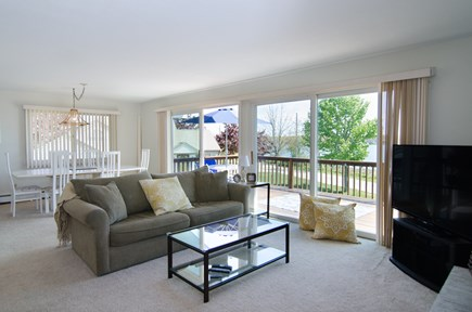 Falmouth Cape Cod vacation rental - Living room/dining room w/access to deck & water views