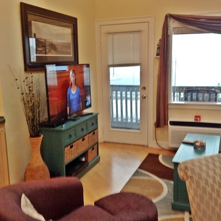 South Yarmouth Cape Cod vacation rental - Dining/living room looking out to deck and water
