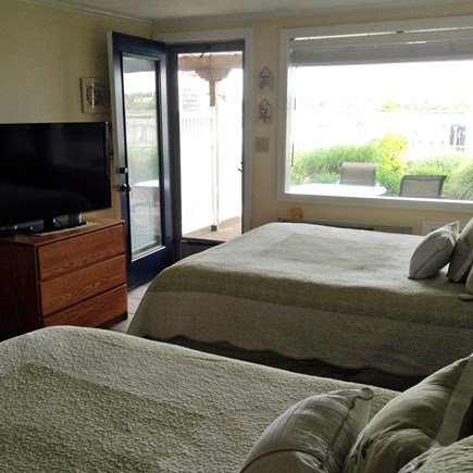 South Yarmouth Cape Cod vacation rental - 2 queen beds with door to patio.  T.V. on both floors