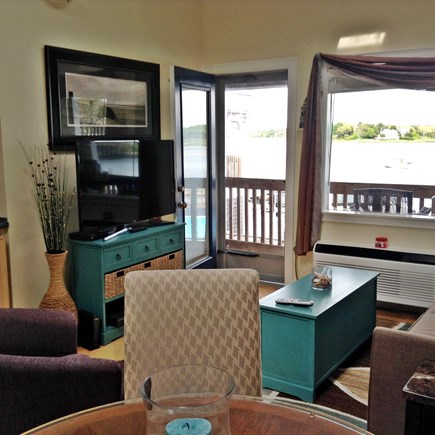 South Yarmouth Cape Cod vacation rental - Living room looking out to deck, water and pool