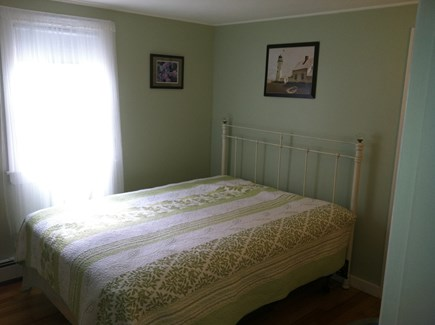South Yarmouth Cape Cod vacation rental - Master bedroom.  Queen bed with half bath and laundry. Cable HDTV