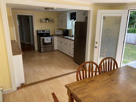 South Yarmouth Cape Cod vacation rental - Dining room with seating for 6 that opens to the backyard patio