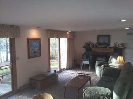 Brewster Cape Cod vacation rental - Living room looking out onto patio and pond beyond