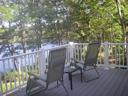 Brewster Cape Cod vacation rental - Deck with pond views accessible from backyard stairs.