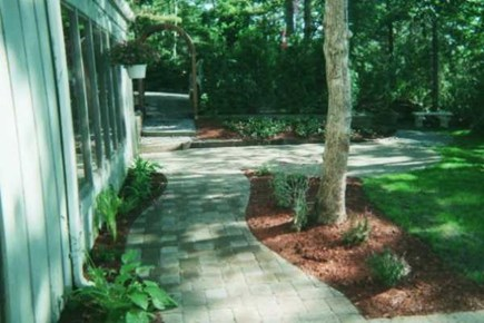 Brewster Cape Cod vacation rental - Walkway to pond side entrance.