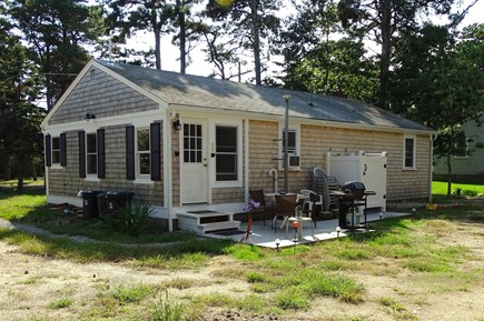 South Dennis Cape Cod vacation rental - Back yard area with grill, dining table