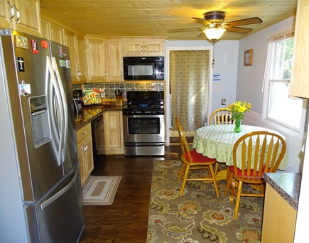 South Dennis Cape Cod vacation rental - Kitchen with seating area, facing sun room