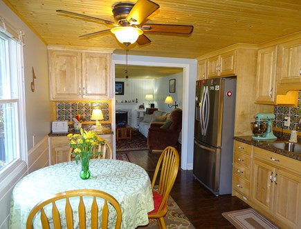 South Dennis Cape Cod vacation rental - Kitchen area with new tile and appliances, facing living room