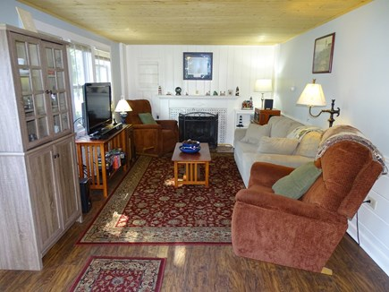 South Dennis Cape Cod vacation rental - Living room with gas insert fireplace and flat screen TV