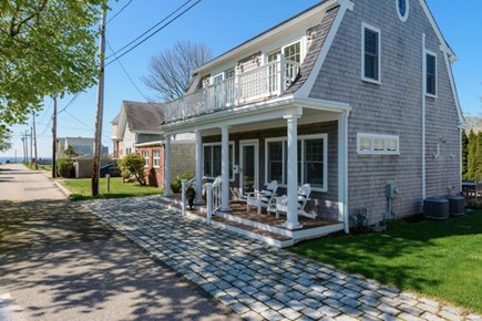 Falmouth Heights Cape Cod vacation rental - Street view with front porch and 4 Adirondack chairs