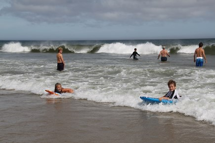 East Orleans Cape Cod vacation rental - Riding the waves at nearby Nauset beach