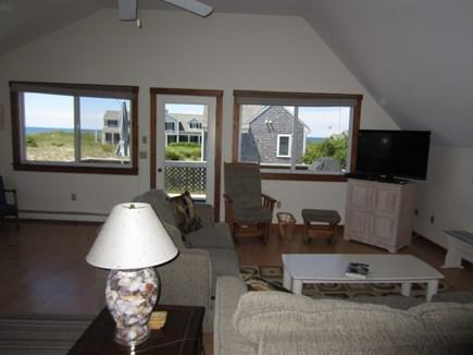 East Dennis Cape Cod vacation rental - Living room towards door to deck