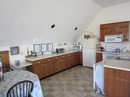 East Dennis Cape Cod vacation rental - Kitchen with table for morning coffee (dishwasher out for winter)