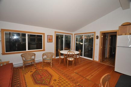 Wellfleet Cape Cod vacation rental - Open plan living area and dining area overlook deck and pond.