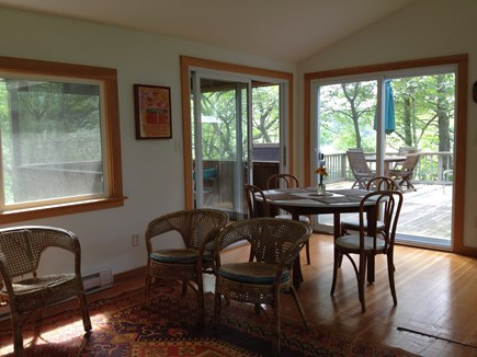 Wellfleet Cape Cod vacation rental - Light filled open dining and living area overlooks deck and pond