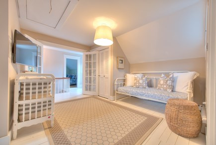 Harwich Port Cape Cod vacation rental - Upstairs family room with twin day bed, central AC, TV, Wii