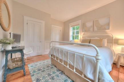 Harwich Port Cape Cod vacation rental - Downstairs guest queen bed with window A/C and TV / DVD
