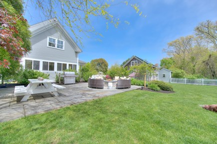 Harwich Port Cape Cod vacation rental - Patio with fire pit, XL gas grill, picnic table