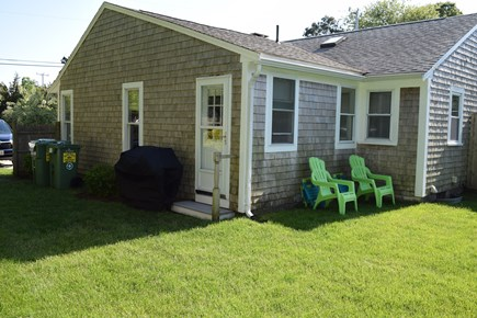South Yarmouth Cape Cod vacation rental - Enjoy the large fenced in back yard with gas grill