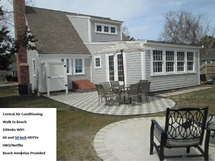 DennisPort Cape Cod vacation rental - Backyard Patio, outdoor shower, ample seating, grill.