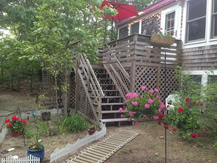 Eastham Cape Cod vacation rental - Side of House with Sunset Deck overlooking large yard
