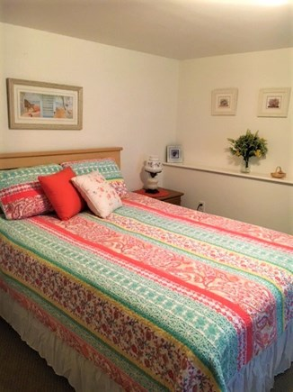 Eastham Cape Cod vacation rental - Queen Room on lower level with dresser and wicker chair