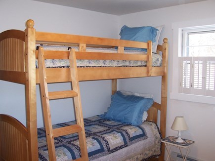 Eastham Cape Cod vacation rental - Bunk Room-main floor-dresser, closet,rocker, child's table/chairs