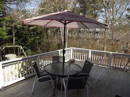 Chatham Cape Cod vacation rental - Outdoor table, chairs, and umbrella on deck