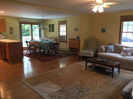 Chatham Cape Cod vacation rental - Open floor plan showing dining area and sliding door to deck