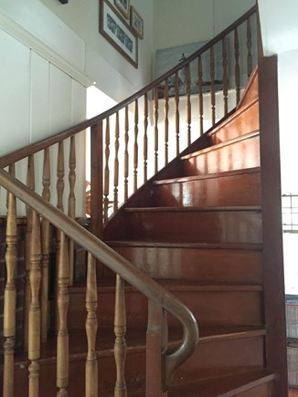 Harwich, Pleasant Beach Cape Cod vacation rental - Handcrafted wood spiral staircase leads to upper level bedrooms