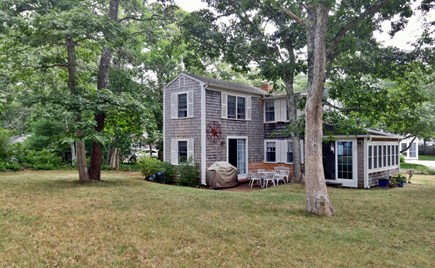 Harwich, Pleasant Beach Cape Cod vacation rental - Plenty of room for play. BBQ and dining table for cookouts too.