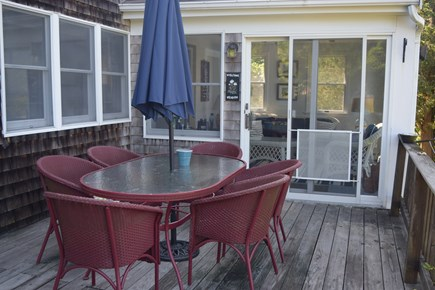 Orleans Cape Cod vacation rental - Enjoy water views and spectacular sunsets from this back deck