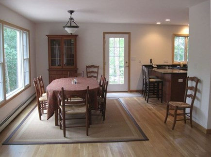 Wellfleet Cape Cod vacation rental - Dining room overlooking porch and wooded areas