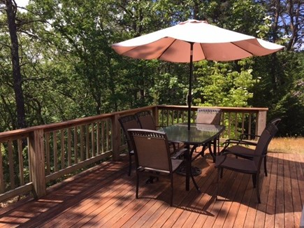 Wellfleet Cape Cod vacation rental - Porch with picnic table overlooking wooded area