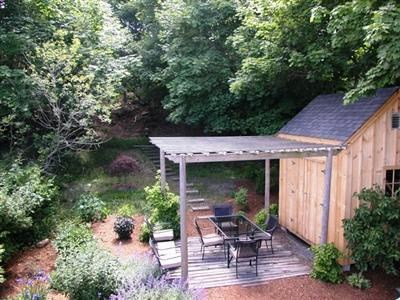 provincetown Cape Cod vacation rental - Landscaped Back yard, common space.  Patio, grill and shed