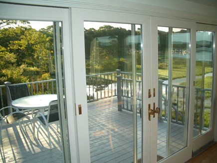 South Dennis Cape Cod vacation rental - View from kitchen outside to the deck and beyond