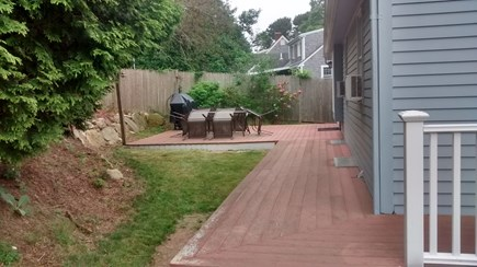 Hyannis Cape Cod vacation rental - Rear deck with BBQ grill & lawn furniture
