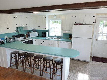 West Chatham in Hardings Beach Cape Cod vacation rental - Kitchen area with seating for six. TV viewable from here.