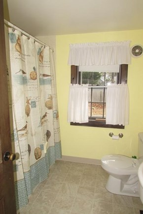 West Chatham in Hardings Beach Cape Cod vacation rental - Downstairs full bathroom with stacking washer/dyer