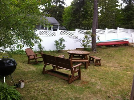 South Dennis Cape Cod vacation rental - Big private yard with Gas & Charcoal grill, table that seats 8