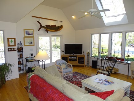 Mashpee Cape Cod vacation rental - Large sunny living room with TV and slider to deck