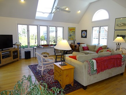 Mashpee Cape Cod vacation rental - Vaulted living room with two couches, skylights